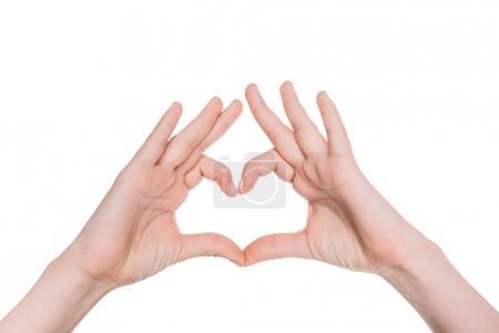 Photo pour Gros plan vue partielle du symbole du coeur de la main isolé sur blanc - image libre de droit