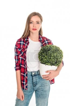 girl with green plant in pot