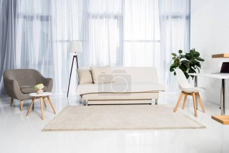 Photo for Beautiful living room interior decorated in pastel colors - Royalty Free Image