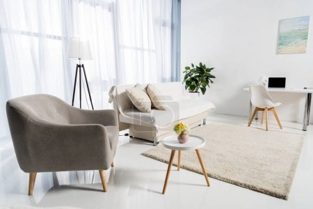 Photo for Cozy living room interior decorated in pastel colors - Royalty Free Image