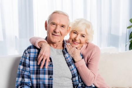 portrait of happy senior husband and wife looking at camera
