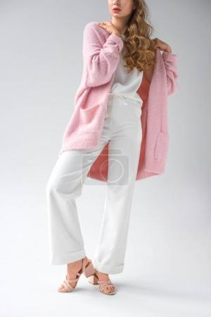 Photo for Cropped image of stylish girl in white trousers and pink shirt posing for fashion shoot - Royalty Free Image