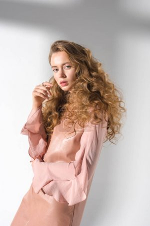 Photo for Attractive girl with curly hair standing and looking at camera - Royalty Free Image
