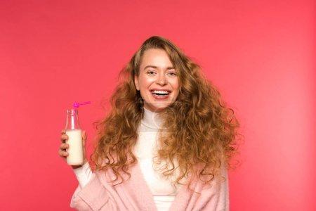 happy woman holding milkshake isolated on red