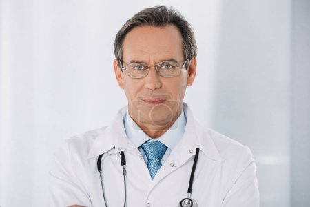 portrait of doctor standing and looking at camera