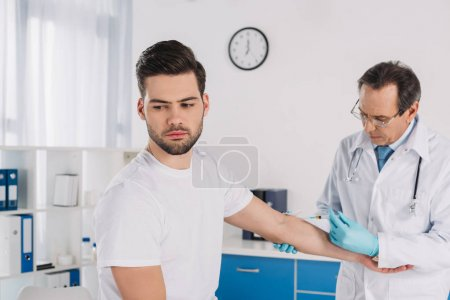 doctor taking patient blood for test