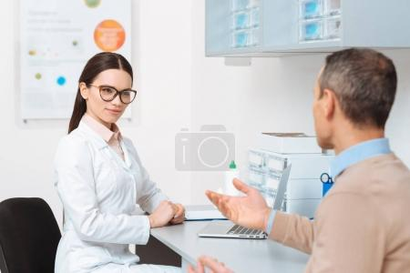 selective focus of patient at the doctors reception in clinic
