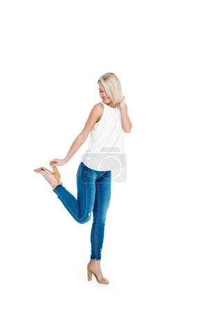 beautiful blonde girl posing in heels, isolated on white