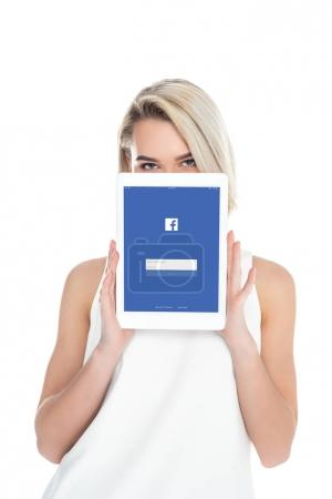 Photo for Woman presenting digital tablet with facebook app, isolated on white - Royalty Free Image