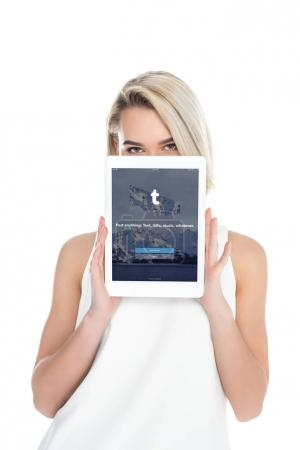 Photo for Woman presenting digital tablet with tumblr app, isolated on white - Royalty Free Image