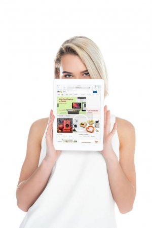 Woman presenting digital tablet with ebay app, isolated on white