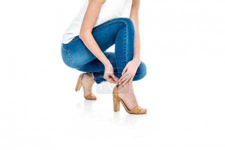 cropped view of stylish woman wearing heels, isolated on white