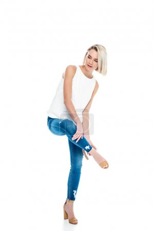 attractive woman in jeans and heels, isolated on white