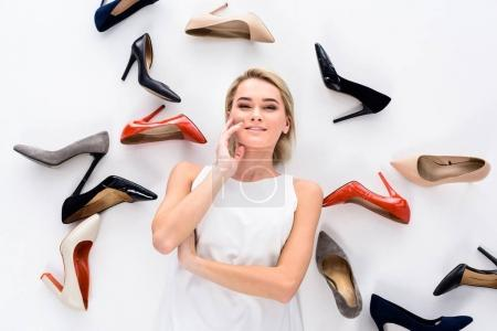 beautiful girl posing with heeled shoes, isolated on white