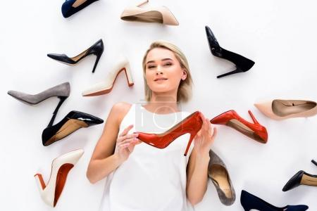 Photo for Attractive woman posing with heeled shoes, isolated on white - Royalty Free Image