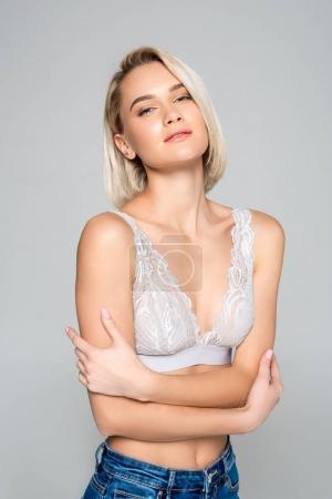 sensual girl posing in bra, isolated on grey
