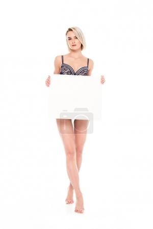 attractive blonde sexy girl in lingerie holding empty board, isolated on white