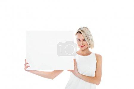 Photo pour Belle fille blonde avec tableau blanc, isolé sur blanc - image libre de droit