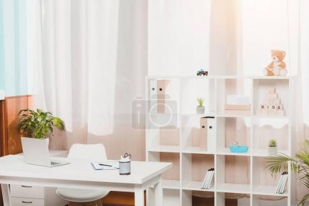 doctors workplace and bookshelf with folders in clinic