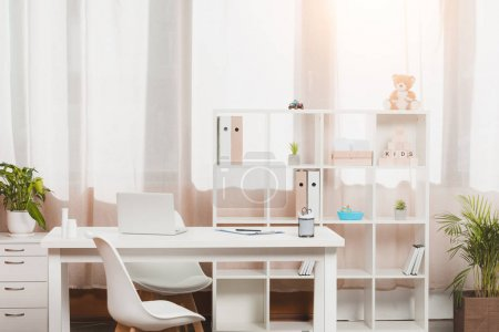 Photo for Doctors workplace and bookshelf with folders in clinic - Royalty Free Image