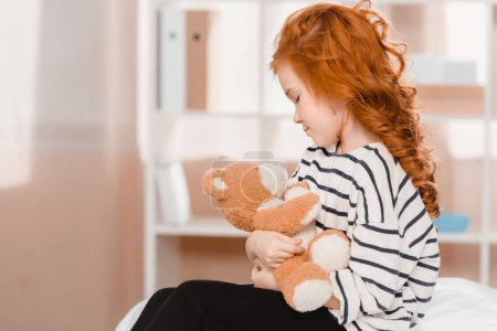 portrait of cute little girl with teddy bear