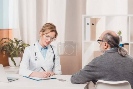 partial view of senior patient at the doctors reception in clinic