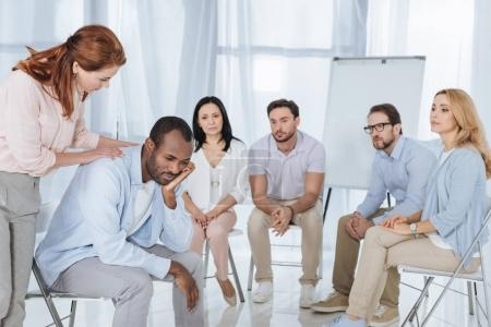 psychotherapist supporting african american man during group therapy