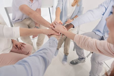 Photo for Cropped shot of people stacking hands during group therapy - Royalty Free Image
