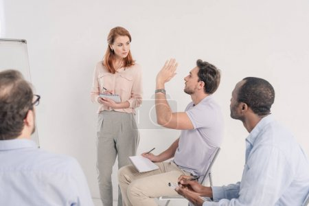 cropped shot of middle aged multiethnic people talking together during anonymous group therapy