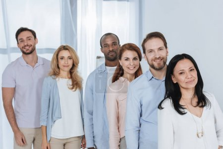 Photo for Multiethnic mid adult people standing together and looking at camera - Royalty Free Image