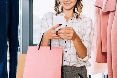Photo for Cropped shot of stylish woman using smartphone on shopping - Royalty Free Image