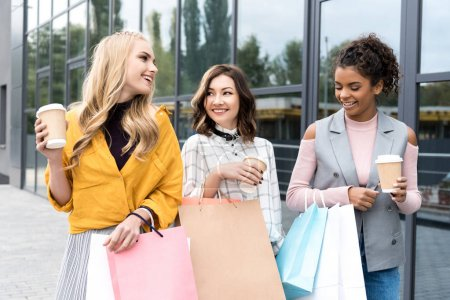 Photo for Group of happy young women with shopping bags and coffee to go - Royalty Free Image