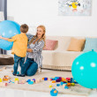 Happy mother and kids playing with fitness balls a...