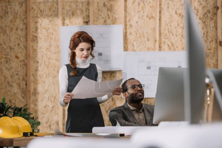 architects discussing building plan while working at office