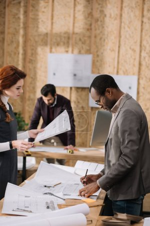 hardworking team of architects working together at modern office