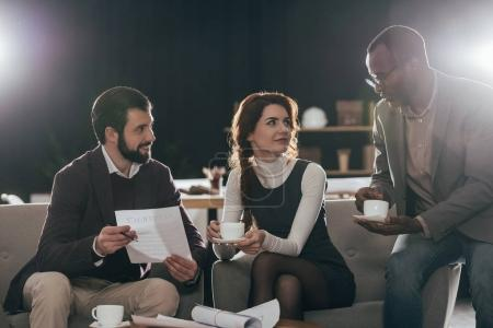 multiethnic businesspeople working together and drinking coffee