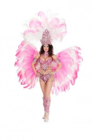 smiling girl posing in carnival costume with pink feathers, isolated on white