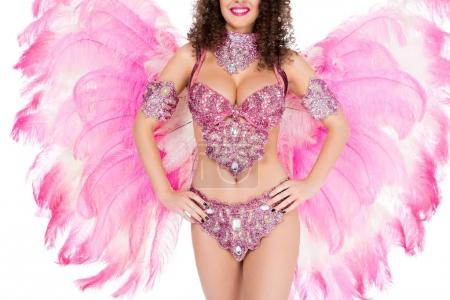 cropped view of girl posing in carnival costume with pink feathers, isolated on white