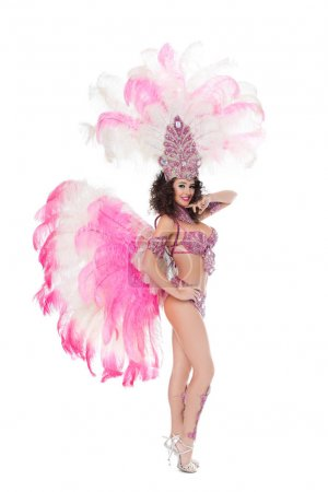 smiling woman posing in carnival costume with pink feathers, isolated on white