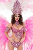 happy woman posing in carnival costume with pink feathers and gems, isolated on white