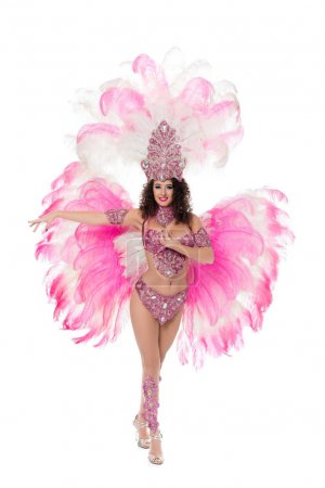 smiling woman dancing in carnival costume with pink feathers, isolated on white