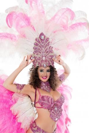 happy woman posing in carnival costume with pink feathers, isolated on white