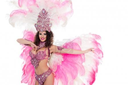 seductive girl dancing in carnival costume with pink feathers, isolated on white