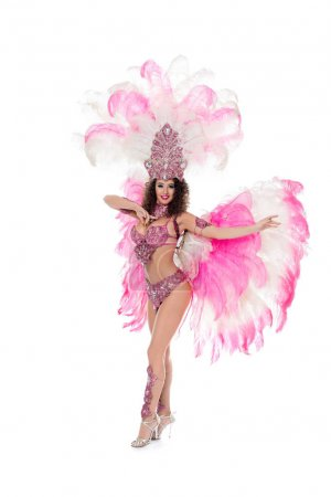 beautiful girl dancing in carnival costume with pink feathers, isolated on white