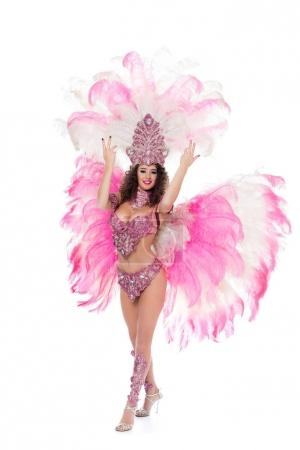 beautiful girl posing in carnival costume with pink feathers, isolated on white