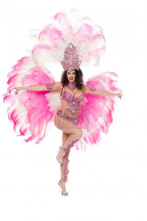 cheerful girl posing in carnival costume with pink feathers, isolated on white
