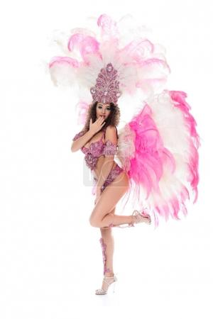 girl with oops gesture in carnival costume with pink feathers, isolated on white