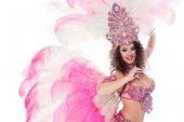 attractive girl posing in carnival costume with pink feathers, isolated on white