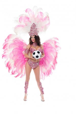 woman in carnival costume with pink feathers holding football ball, isolated on white
