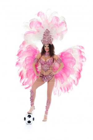 woman in carnival costume with ball at her legs, isolated on white